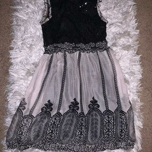 Black and Grey with black sequins. Mid knee length